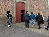 The piper plays as the guests arrive